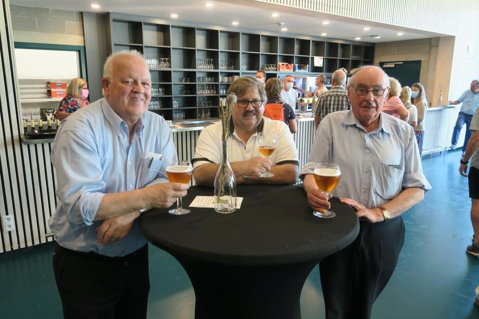 Eddy Smits van de cultuurraad en harmonie De Verbroedering met twee andere muzikanten.