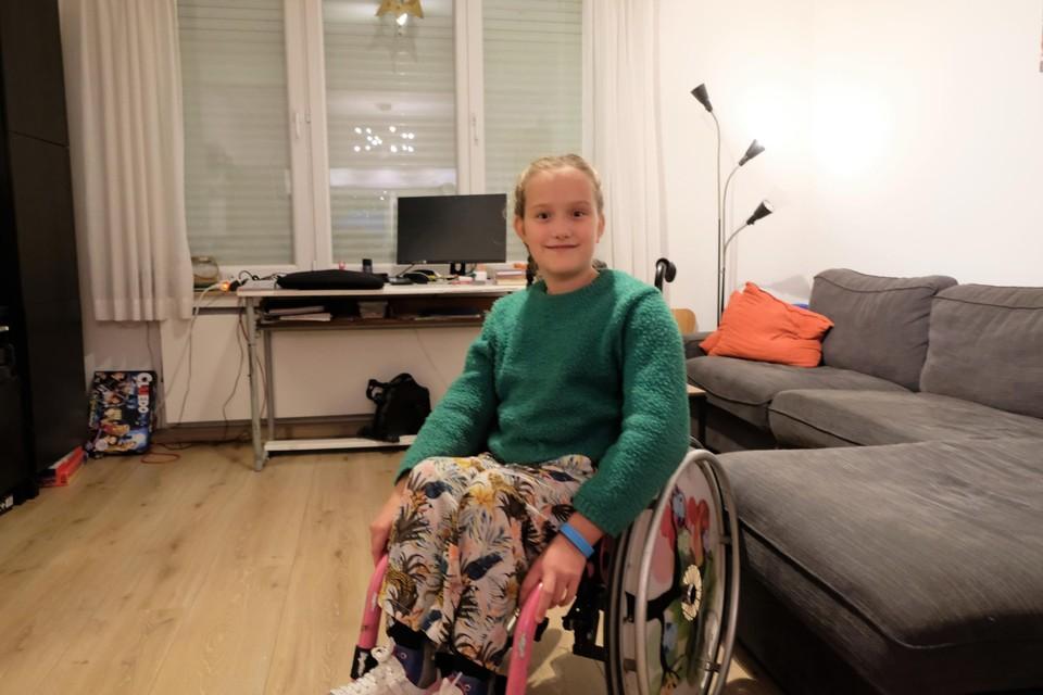 Lore in haar rolstoel.