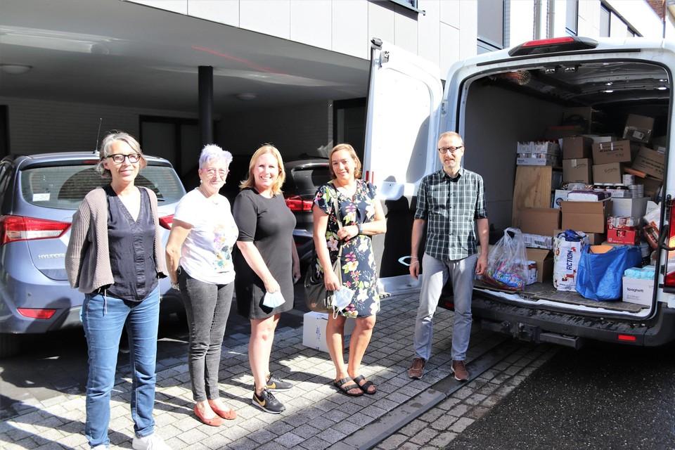 Het Mechels team van vrijwilligers met in het midden Marijke Lamon.